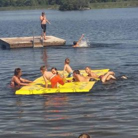 Kids playins in the lake