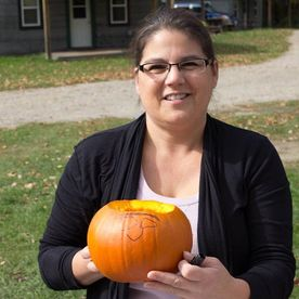 Woman holding a little pumpkin
